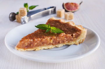 Piece of homemade tart with caramel filling