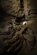 man at entrance of dark cave