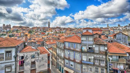 View of the city of Porto: houses around Riber and church Klerig