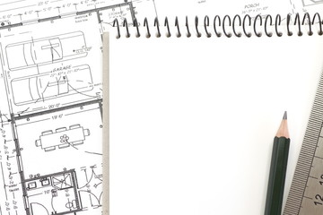 Blank white paper note book with architectural plan,