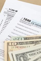 U.S. income tax form and dollar bill