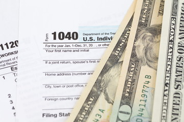 U.S. income tax form and dollar bill