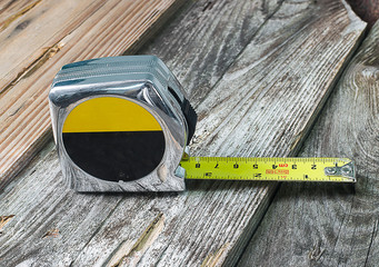tape measure isolated on wood background
