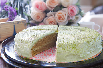 close up big pound of green tea cake sliced on table top