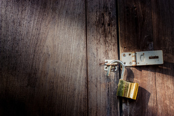 brass lock on wooden door