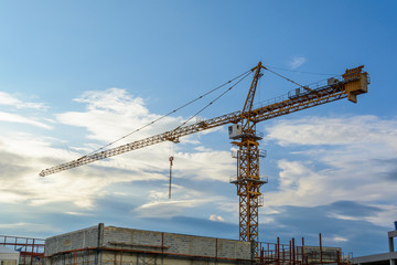 construction cranes with blue sky