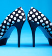 Dotted high heels shoes close up, fashion concept