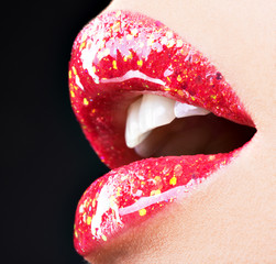 beautiful female lips with shiny red gloss lipstick