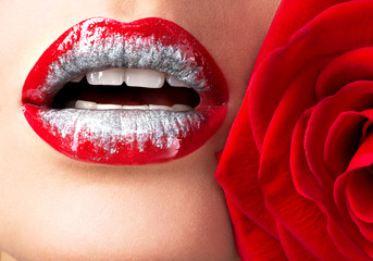 beautiful female lips with shiny  lipstick and red rose