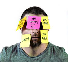 man with face full of post it notes reminders and resolutions
