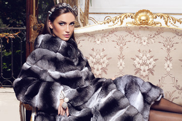 Fashion model posing in a fur coat