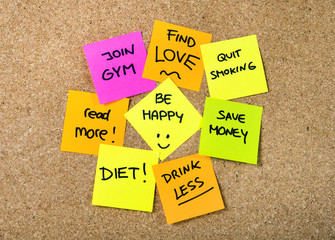 New year Resolutions Post it notes on cork board