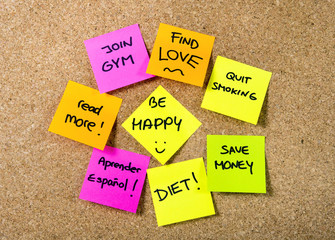 group of New year Resolutions Post it notes on board