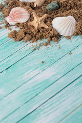 Marine items on sand  on wooden background.