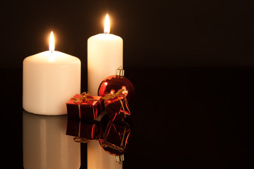 White candles with Christmas decorations