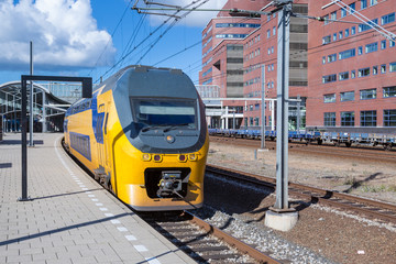 Dutch intercity train leaving the central station of Amersfoort