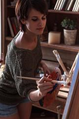 Female artist painter in her studio