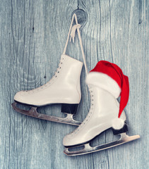 Pair of White Ice Skates and Santa Claus hat - backround on vint