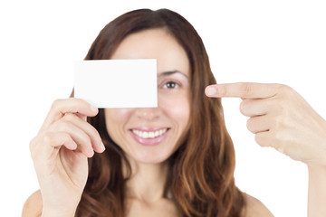 Young woman showing an empty white sign card