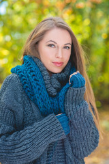 Pretty Blond Woman in Thick Gray Knit Jacket