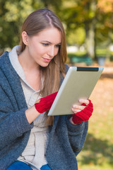 Smiling Young Woman Busy with Apple Ipad
