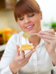 Smiling Woman Putting Honey on Bread