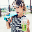 canvas print picture - Sporty woman with color ball drinking water