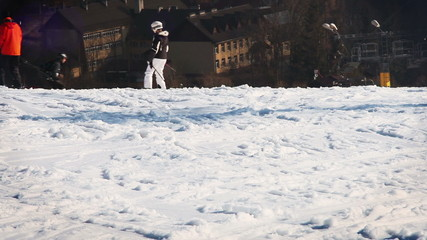 Skiers and snowboarders on the ski resort slope