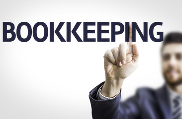 Business man pointing the text: Bookkeeping