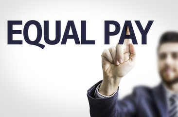 Business man pointing to transparent board with text: Equal Pay