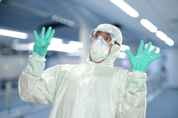 Scientist in full protective hazmat suit