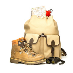 Vintage backpack with hiking boots, map and bottle