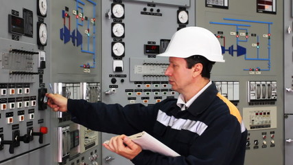 engineer looks and writes technical parameters in log