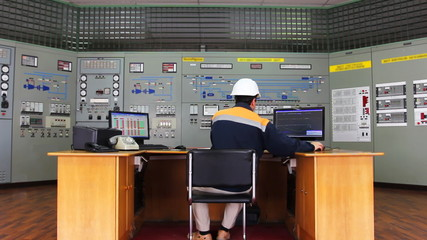 engineer works at table in front of panel process control