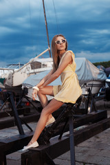 Pretty girl on sea and yacht background