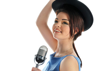 Portrait of beautiful young smiling girl  with retro microphone