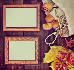 Photo frames with yellow leaves and old jewelry