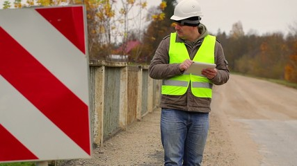 Engineer with tablet PC on the bridge
