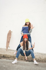 Two young  hipster girl friends