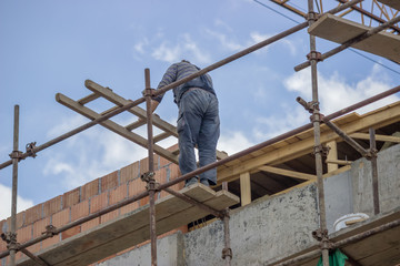 Construction worker on top of a new building