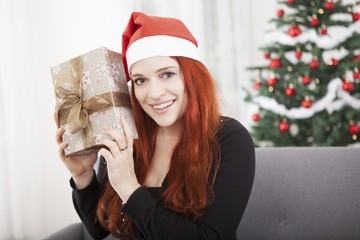 girl is happy hold christmas present
