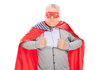 Senior in superhero costume tearing his shirt