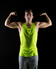 young man showing biceps