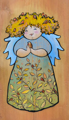 Cute angel with bird painted on a wood.
