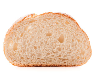 Hunk or slice of fresh white bread isolated on white background