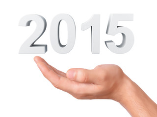 hand hold New Year 2015 on white background