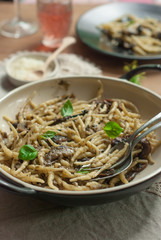 Freshly cooked pasta(trofie) with mushrooms, vegetable and parme