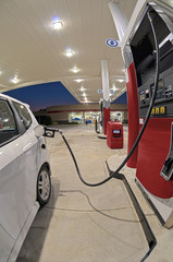 Small Car Refueling At Gasoline Station Convenience Store