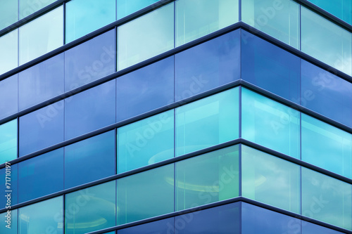 Modern office facade fragment with blue green glass - 71710197