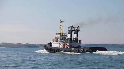 Black tug is underway on Black sea, Bulgaria